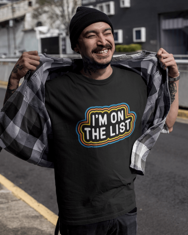 smiling-tattooed-asian-man-wearing-a-round-neck-t-shirt-mockup-outdoors-a17067